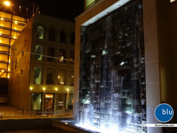 Custom outdoor water feature with lights by Bluworld