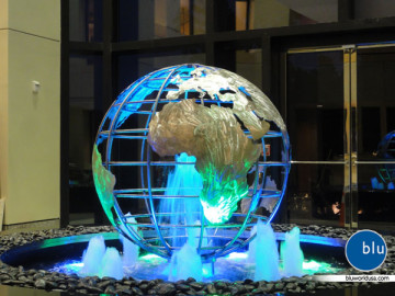 Custom globe water fountain sculpture by Bluworld